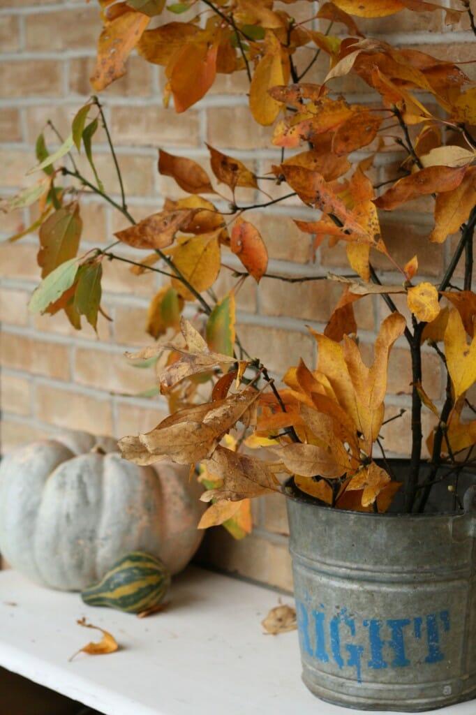 using fall branches as porch decor