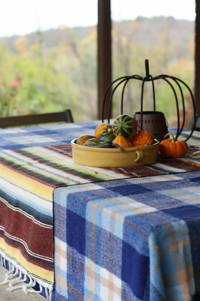 layered plaid and mexican blankets as tableclothes
