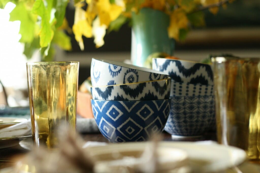thanksgiving table with eclectic bowls and vintage amber glassware