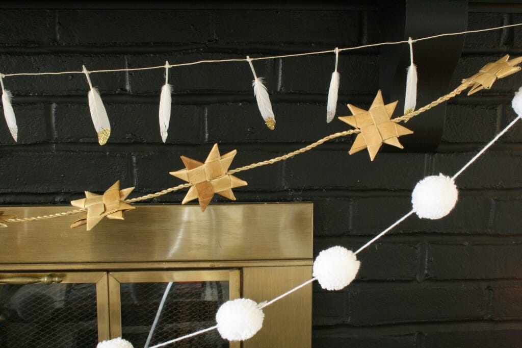Mantle with feather garland, pom pom garland, and rustic moravian star garland