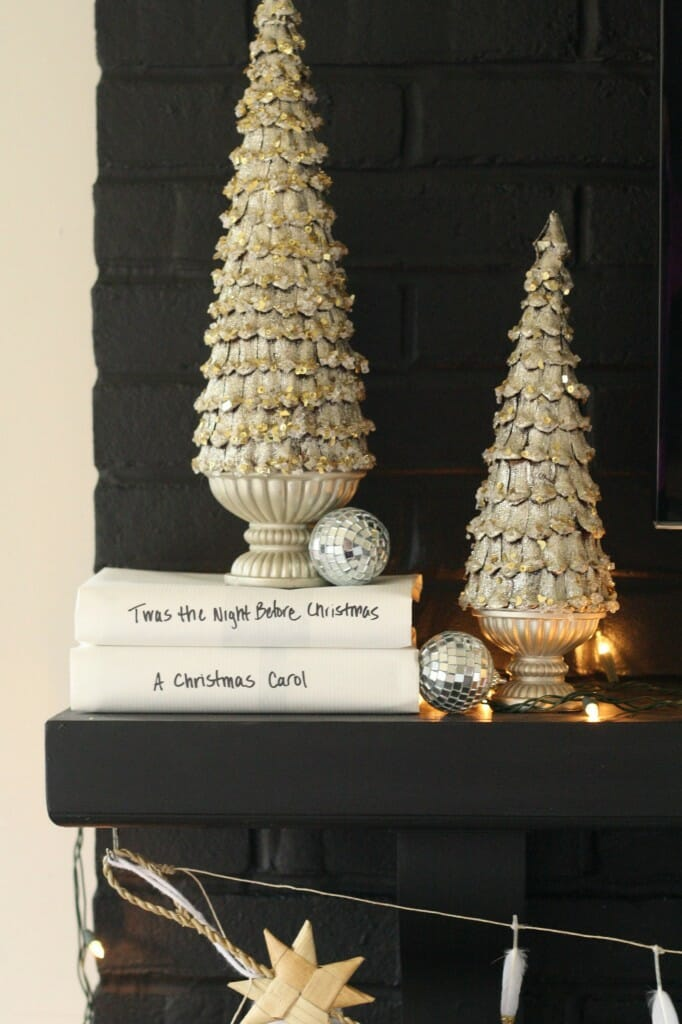 holiday mantle in black and white and sparkle