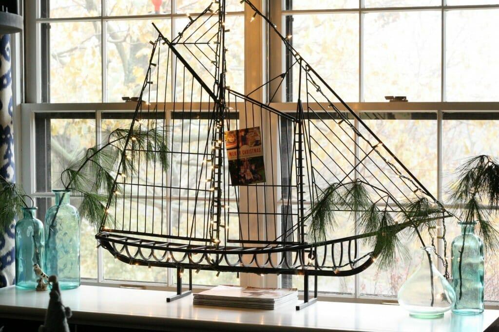 midcentury boat sculpture as card display