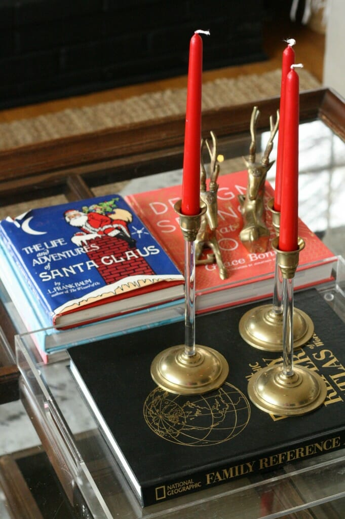 christmas coffee table with vintage book and red candles