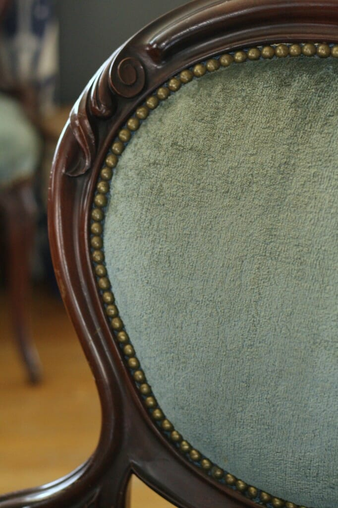 gorgeous nailhead trim and details on dusty blue velvet chairs