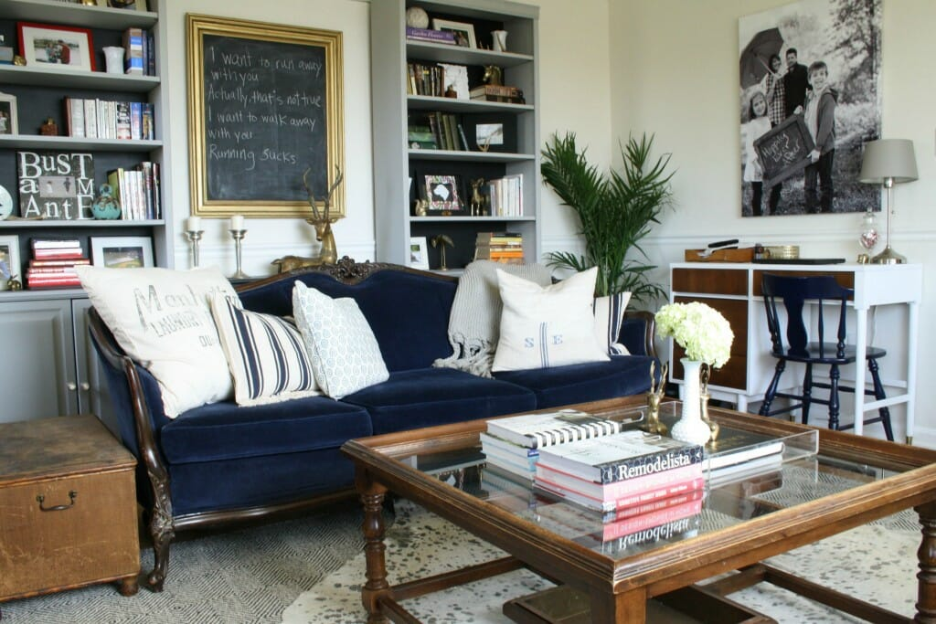 Spring Living Room in Navy, black, white, gold, and wood tones