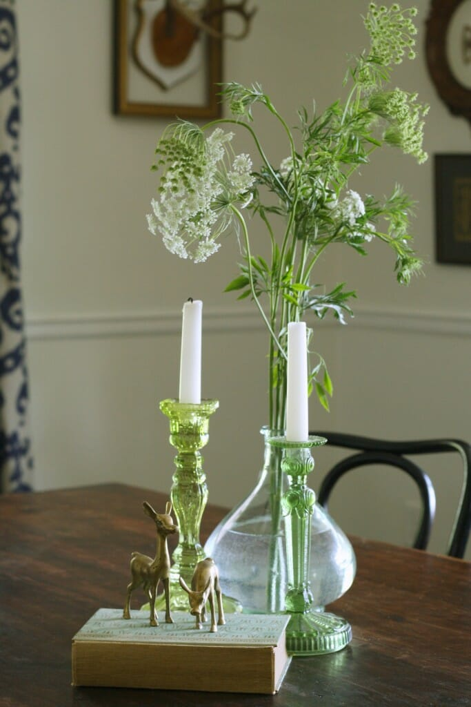 Green glass, and greens on dining table