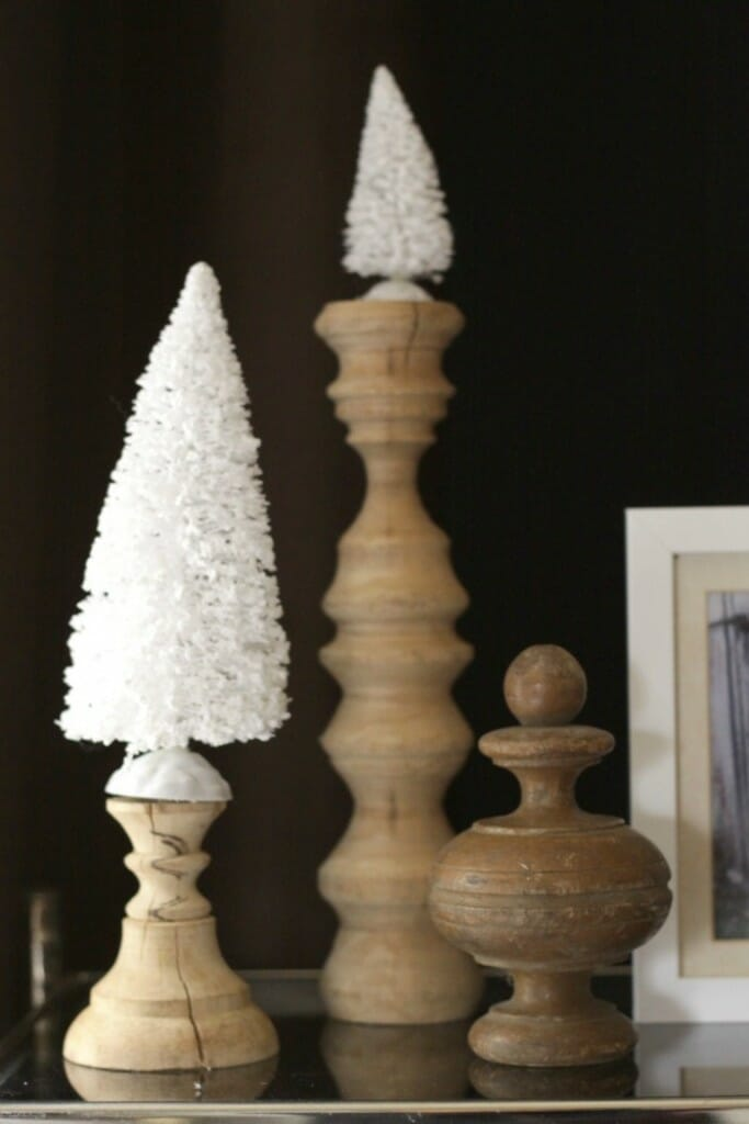 Wooden pieces with white bottle brush trees