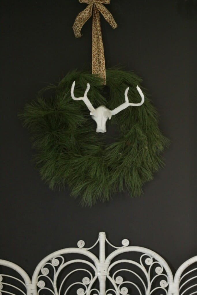 Natural wreath above bed