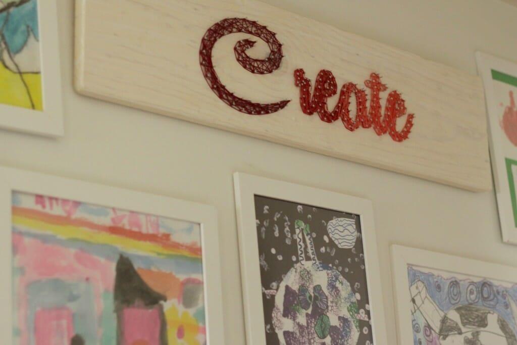 String art in kids art gallery wall