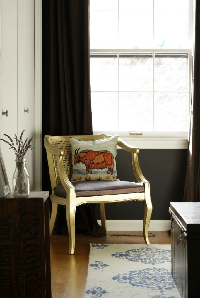 Gold barrel chair with crewel work pillow