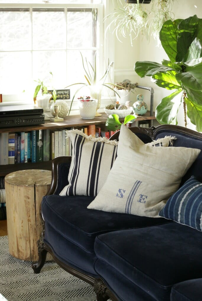 Navy vintage velvet couch with grainsack pillow