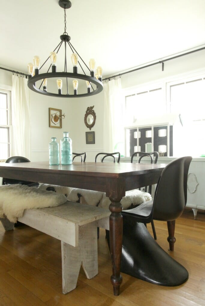 Eclectic Dining Room with bentwoods and bench and panton chairs