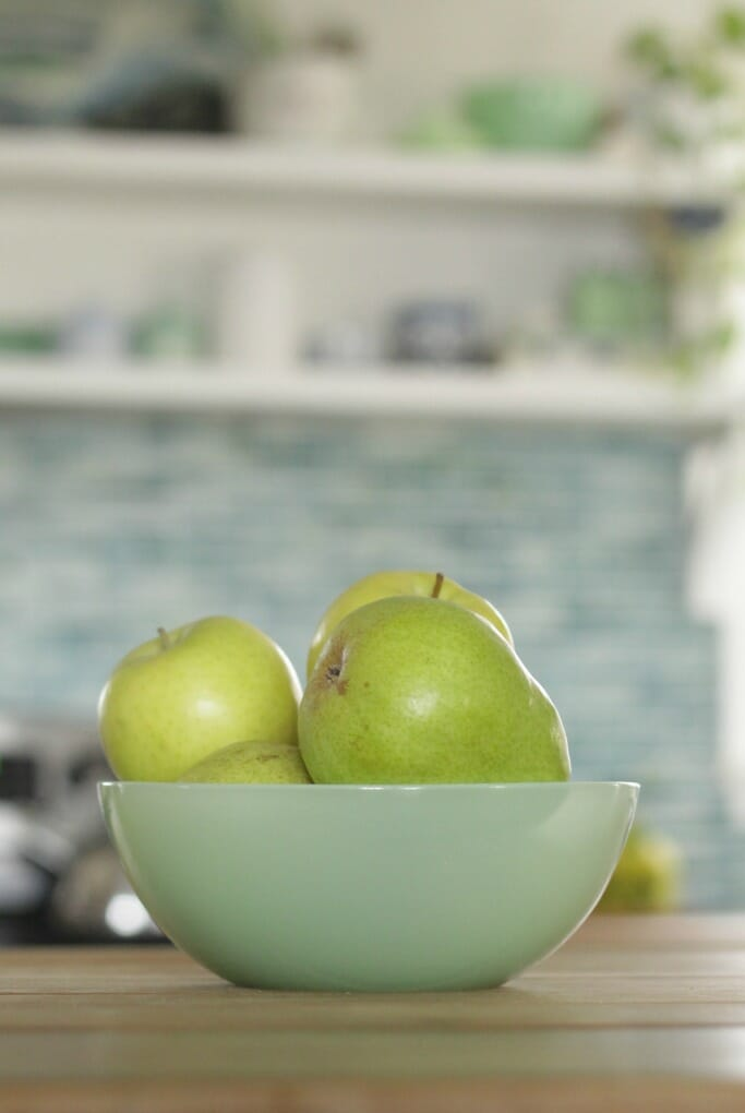 Jadeite bowl with golden delicious apples and pears
