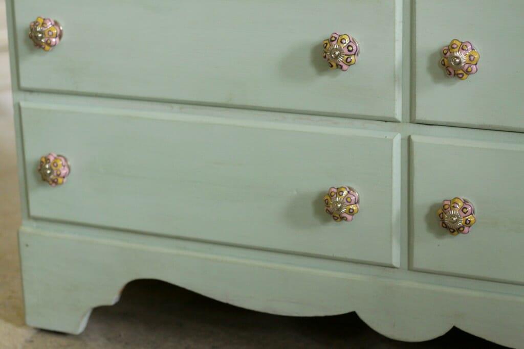 Scalloped details of mint dresser
