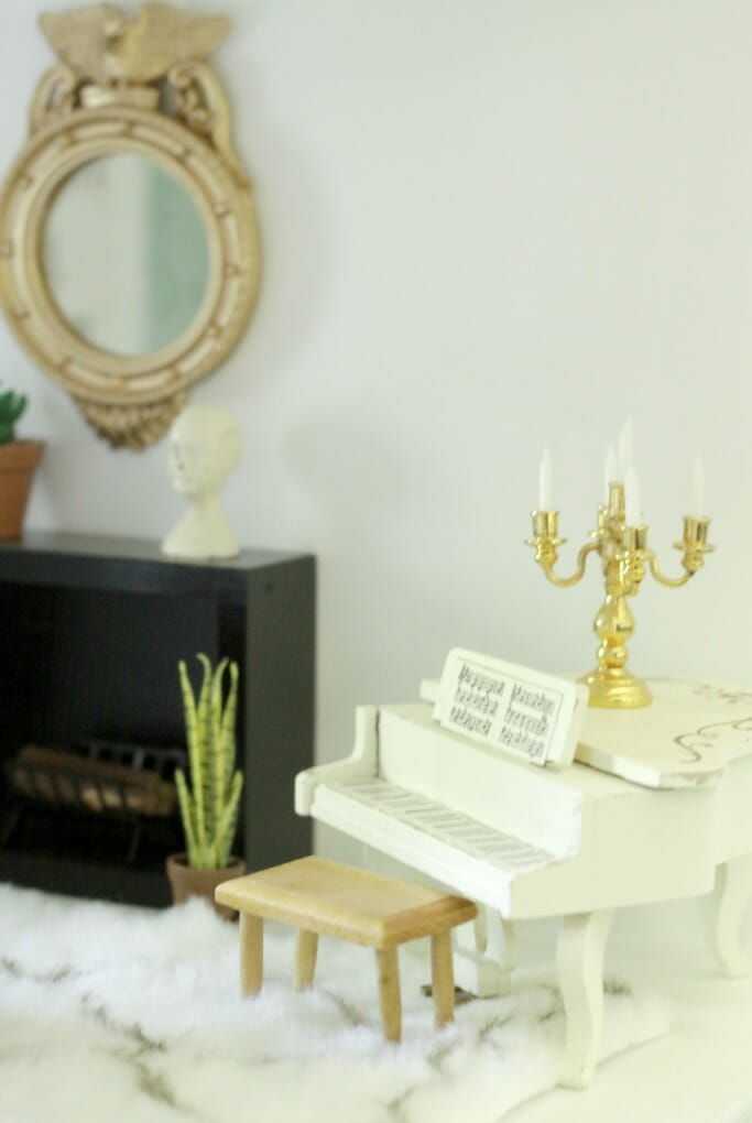 Baby grand piano in dollhouse
