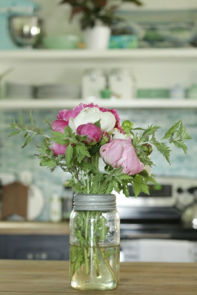 Jar of peonies on kitchen island