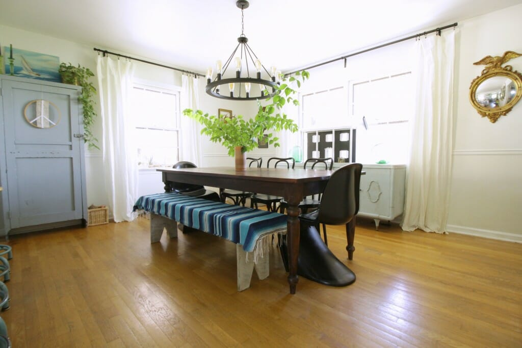 Eclectic Dining room in blue, black, white with sarape on bench