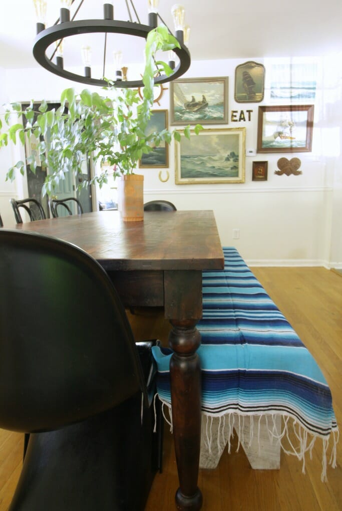 Seascape gallery wall in dining room