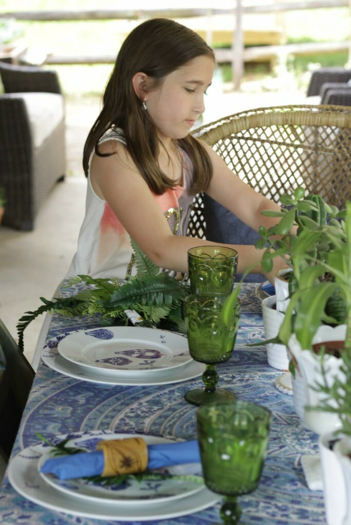 Emmy helping with tablescape